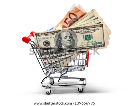 Ready for shopping - grocery cart full of cash isolated on white  - stock photo