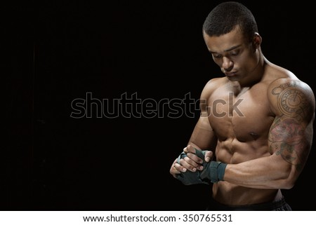 Ready for the battle. Studio shot of a handsome African male boxer posing against black background copyspace on the side - stock photo