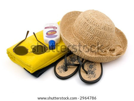 Ready for the Beach?   Towel, Sunglasses, Straw Hat, Sun Block, Sandals Isolated on White Background - stock photo