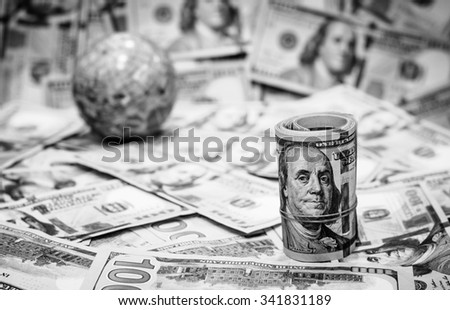 Ready for travel around the world with  American dollars currency,money on black and white color,Focus on roll of one hundred dollars and blurry background,globe - stock photo