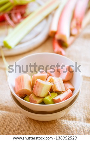 ready fresh raw rhubarb cut in a bowl - stock photo