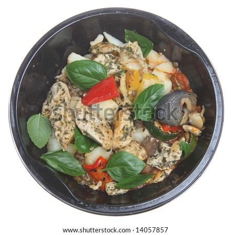 Ready-meal of Lemon Chicken with Basil in a plastic microwave container - stock photo
