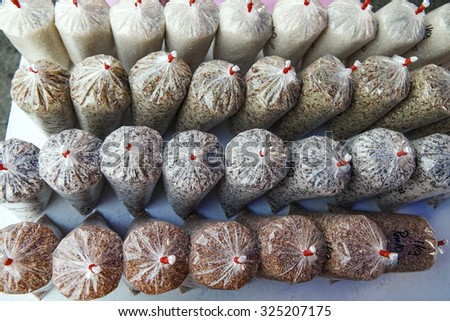 Ready pack mixed rice selling at local sunday market. Selective focus with shallow depth of field. - stock photo