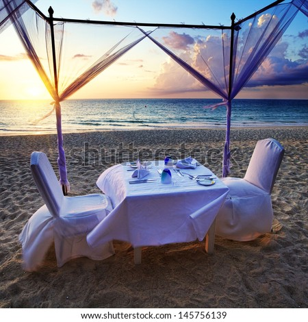 Ready romantic dinner on the beach - stock photo