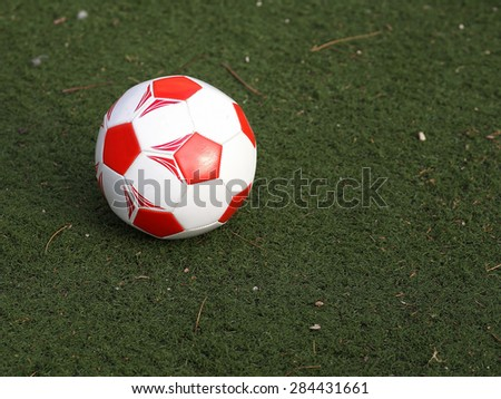 Ready to be kicked A soccer ball on the field ready to be kicked for a crucial goal to score.   - stock photo