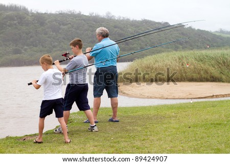 ready to cast fishing rods - stock photo