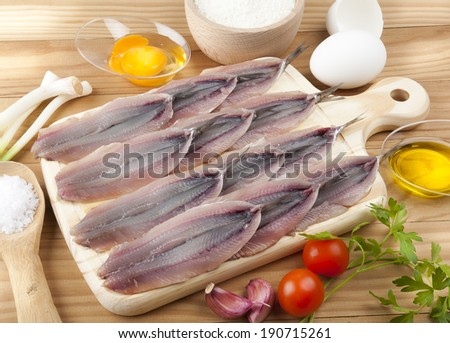 ready to cook fresh anchovies - stock photo