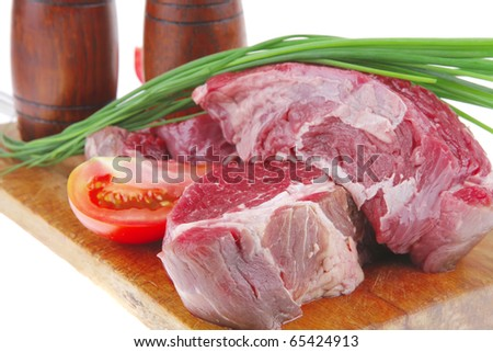 ready to cook: raw beef fillet mignon on cutting board prepared for roasting - stock photo
