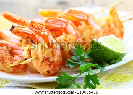 ready to eat grilled shrimp with lime and parsley - stock photo