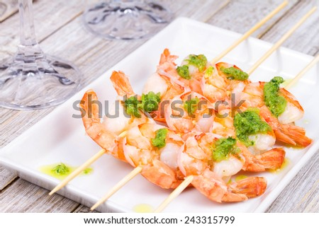 Ready to eat shrimps with green butter - stock photo