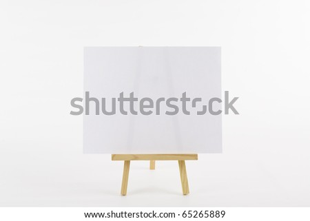 Ready to fill message board of table top easel and blank paper on white background - stock photo