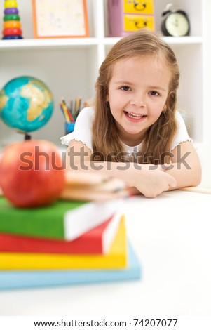 Ready to learn - back to school concept with smiling little girl