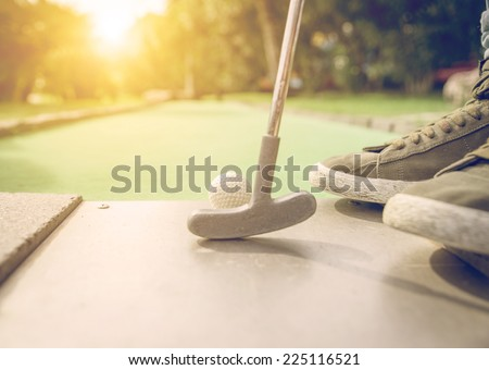ready to shoot the ball in the hole. golf and mini golf - stock photo