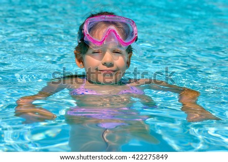 Real adorable toddler girl enjoying her summer vacation at beach - stock photo