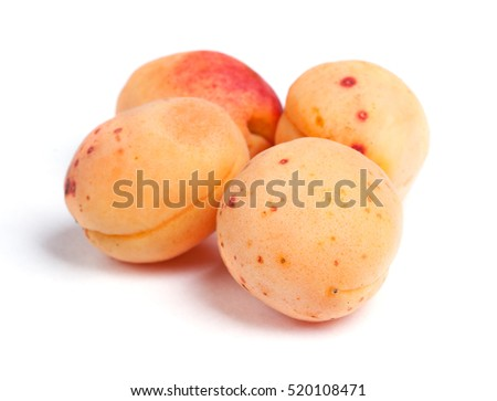 Real apricots isolated on white background