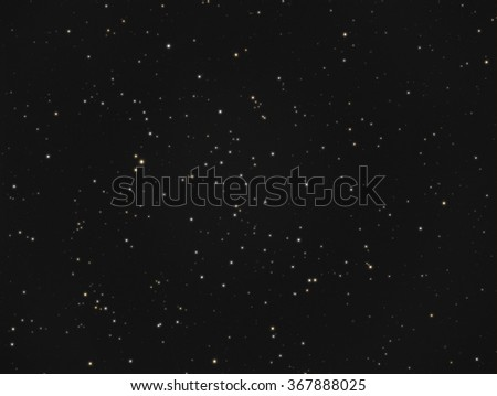 Real astronomic picture taken using telescope, it is an open stars cluster located in the constellation andromeda, and is known as ngc 752 or caldwell 28 - stock photo