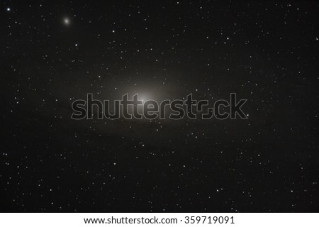 Real astronomic picture taken using telescope of the famous galaxy in andromeda constellation - stock photo