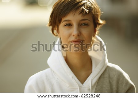 real beautiful girl on the street background, natural light - stock photo