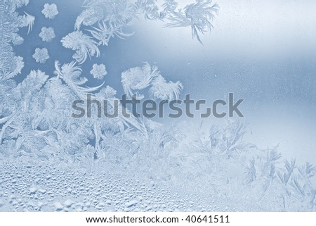 Real beautiful snowflake on the window glass - stock photo