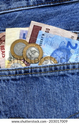 real, brazilian money, in the pocket of jeans - stock photo