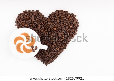 Real capuccino decorated with cinnamon an coffee beans - stock photo