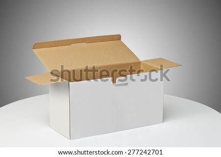 Real Cardboard box opened ready for packaging and delivering - stock photo