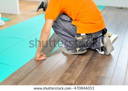 Real carpenter doing laminate floor work