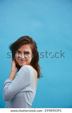 Real casual style model against blue wall - stock photo