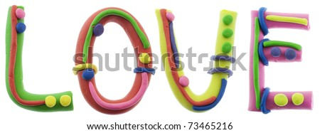 Real cheerful plastic plasticine alphabet- L, O, V, E letters, LOVE word. Isolated on white - stock photo
