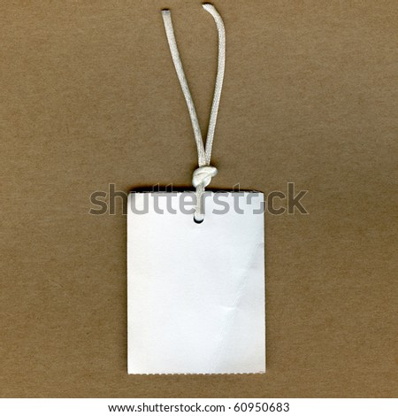 Real Clothing Tag On Brown Paper - stock photo