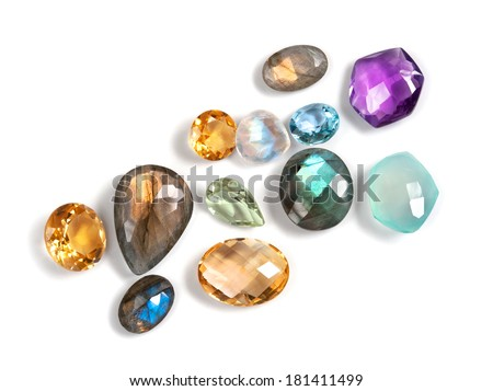 Real colorful gemstones isolated on white background. Many different colors, shapes and cuts. - stock photo