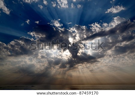 Real dark sky with sun and sunbeams in the Portuguese Coast - stock photo