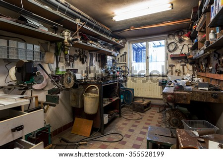 real dirty domestic DIY home workshop full of tools, untidy, ready for work - stock photo