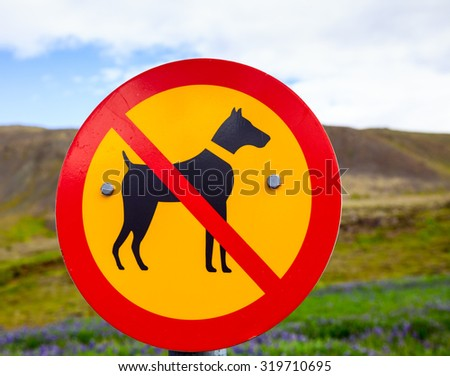 Real Dogs Are Not  Allowed sign in a park - stock photo
