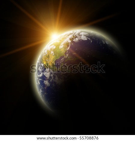 Real Earth Planet in yellow sun - stock photo