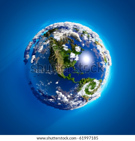 Real Earth with oceans, mountains and the atmosphere in the Sunlight - stock photo