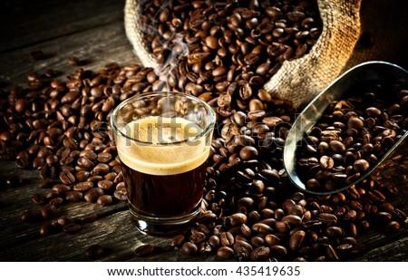 real espresso and coffee grain - stock photo
