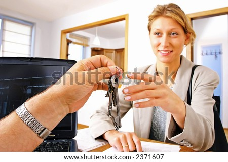 real estate agent handing keys to client, buyer - stock photo