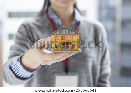 Real estate agent having a residential model - stock photo
