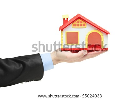 Real estate agent holding a model house in a hand isolated on white - stock photo