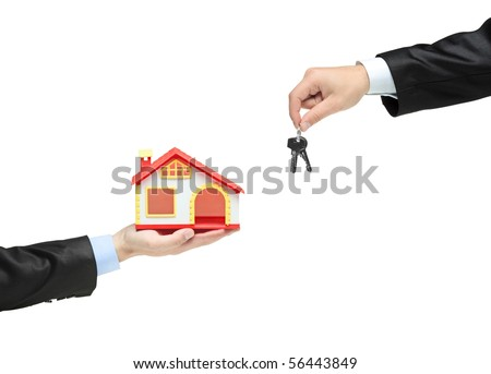 Real estate agent holding keys from your new house - stock photo