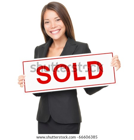 Real estate agent holding sold sign isolated on white background. Beautiful cheerful Asian / Caucasian female realtor smiling confident in black suit. - stock photo