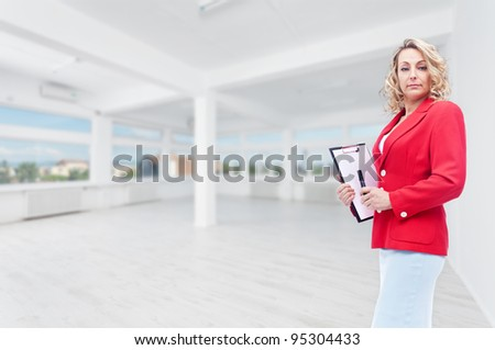 Real estate agent in large office space to let - stock photo