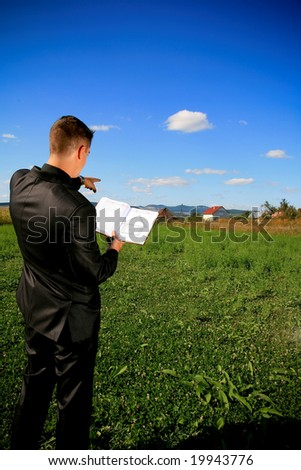 Real estate agent locating a piece of land - stock photo