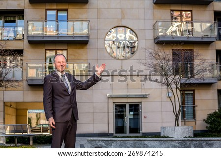 Real estate agent presenting a nice property - stock photo