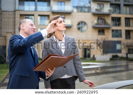 Real estate agent presenting new apartment - stock photo