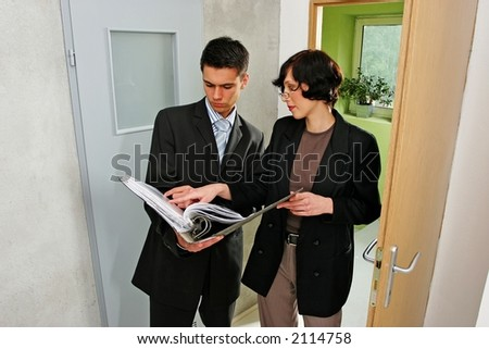 real estate agent showing a flat to a potential client - stock photo