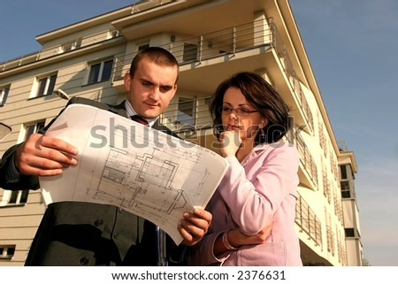 real estate agent showing flat location to potential buyer - stock photo