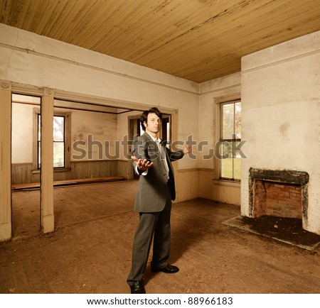 Real Estate agent showing off rundown but potential property
