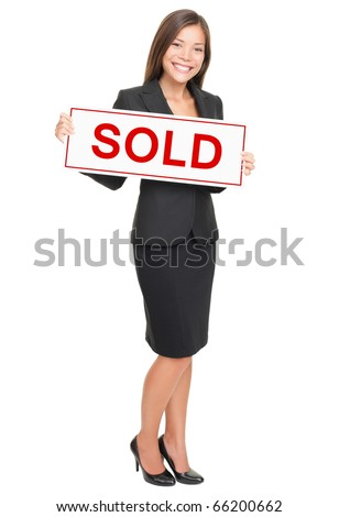 Real estate agent showing sold sign isolated on white background. Beautiful smiling Asian / Caucasian female realtor standing confident in full length. - stock photo